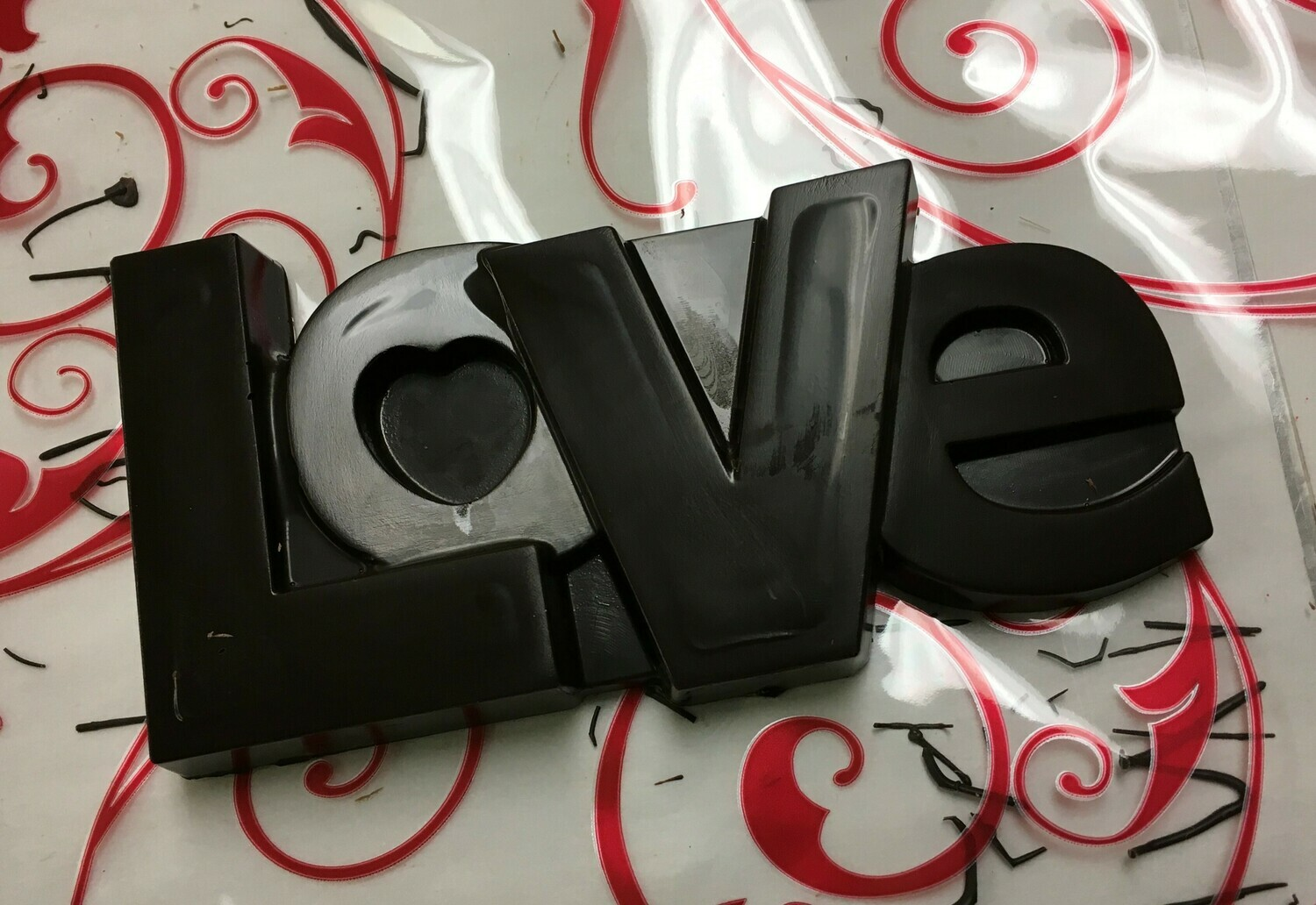 Solid Love!  Milk or Dark Chocolate.  Wrapped in clear with bow!