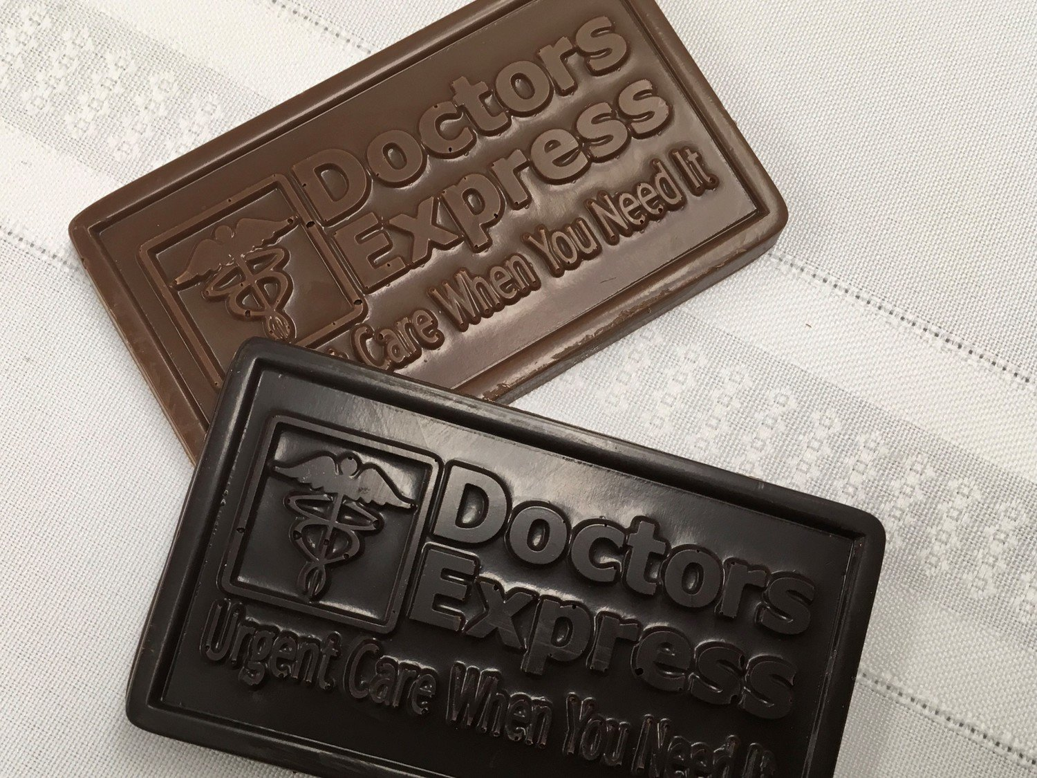 Chocolate Business Card. Upload you business logo in a JPG for Proof. Made on premises. Price is for mold and 50 Chocolate Bars (price may vary depending on logo) Addt'l bars $1.99 per bar.
