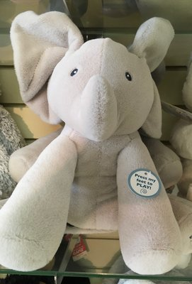 Interactive Gund Elephant.  Ears Wiggle and sings.  Adorable.