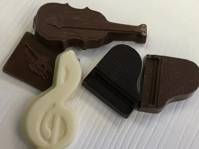 Mixture of Milk, Dark and White Musical Insruments.  Solid Chocolates.