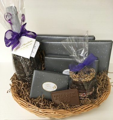 Carella's Chocolates Gift Basket.  Included Choc Covered Sparkling Cider, Gourmet Pretzels, Mini Pretzels, Truffles, Nuts and Asst. Chocolates.  Choc Bar optional.