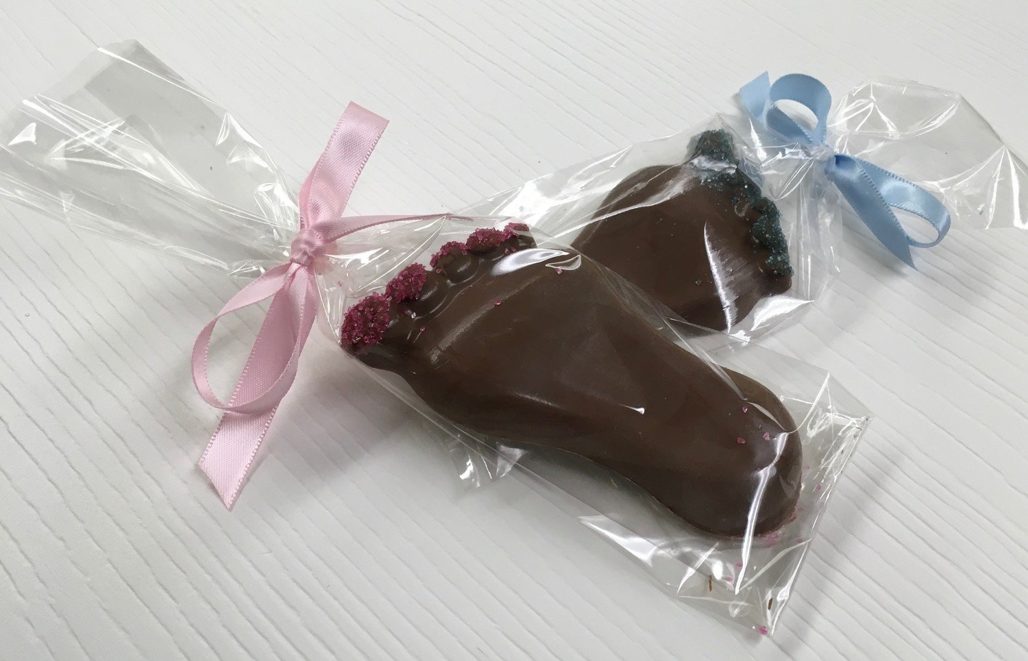 "Solid Chocolate Baby Feet.  4"" x 2""  Peanut and Gluten Free.  Bag and Bow not included.  8 to a Lb."