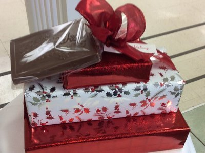 F - 3 Tiered Chocolate Asst. Plus Holiday Greetings Milk Chocolate Bar. Boxed Assortments include 2 Lb. of Asst. Chocolates, 1.25 Lb. of Asst. 3 Ring Pretzels, 1/3 Lb. Mini Pretzels Assorted.