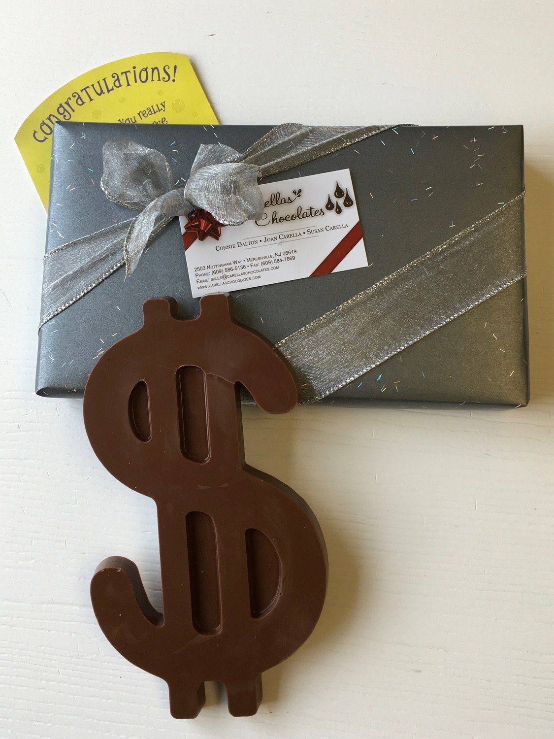 "F - Boxed and Wrapped 1/2 Pound Chocolate Dollar Sign.  Peanut and Gluten Free.  Approx. 6""x4""."