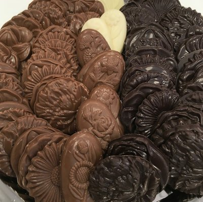 F - Assorted Chocolate Flowers. 1 1/2 approx.  Peanut and Gluten Free.  52 to a Lb.
