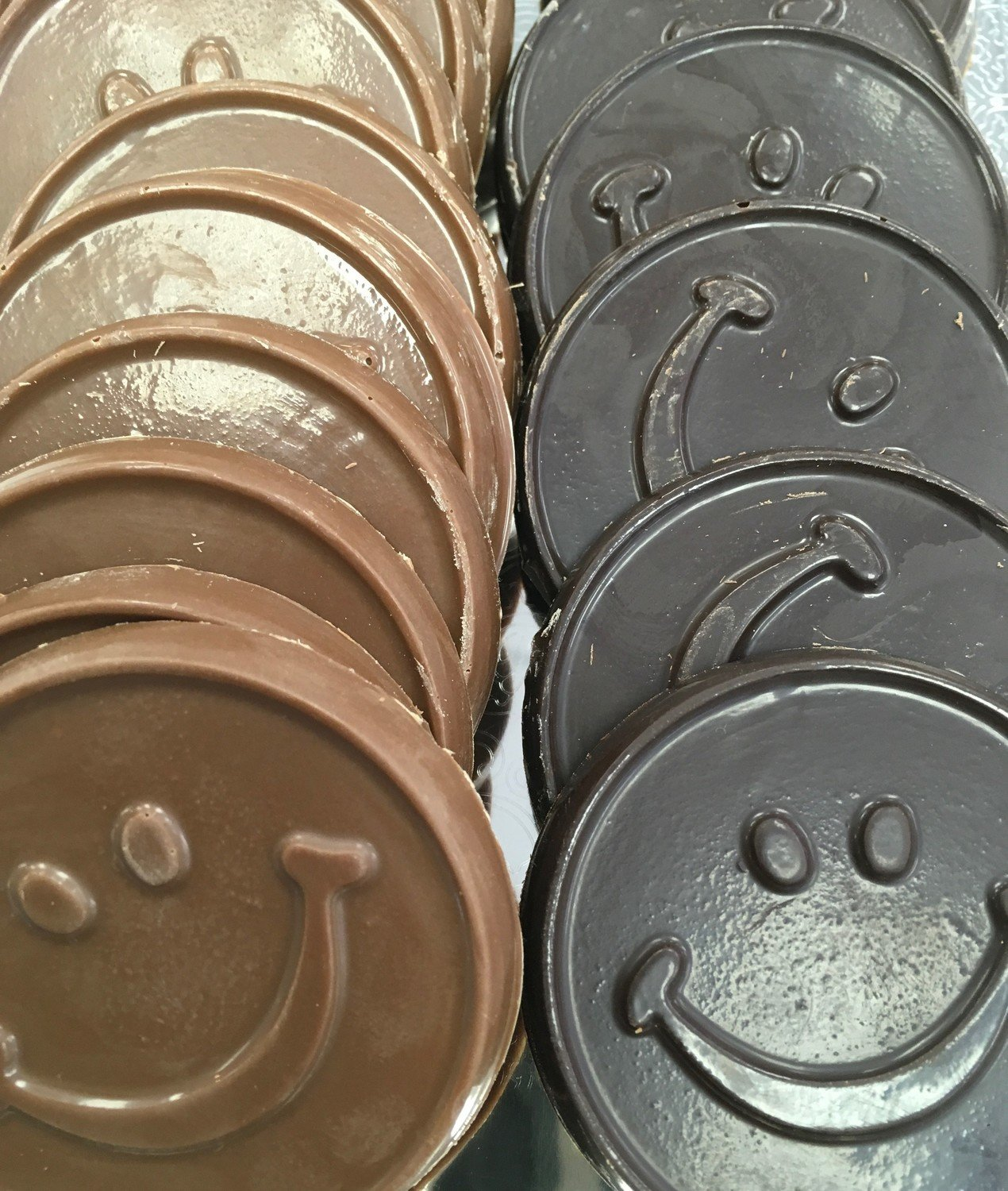 "F - Chocolate Smiley Faces. 2 1/4"" approx.  Peanut and Gluten Free. 20 to a Lb."