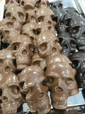 Halloween Chocolates Skulls 28 to a Pound.  Peanut and Gluten Free