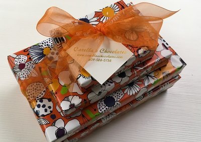 4 Tiered Boxes wrapped and bowed.  2Lb. Asst. Mk Dk Chocolates, 1 Lb. Truffles, 1/2 Lb. Hard & Chewey Mk Dk, 1/3 Lb. nonpariels Mk Dk