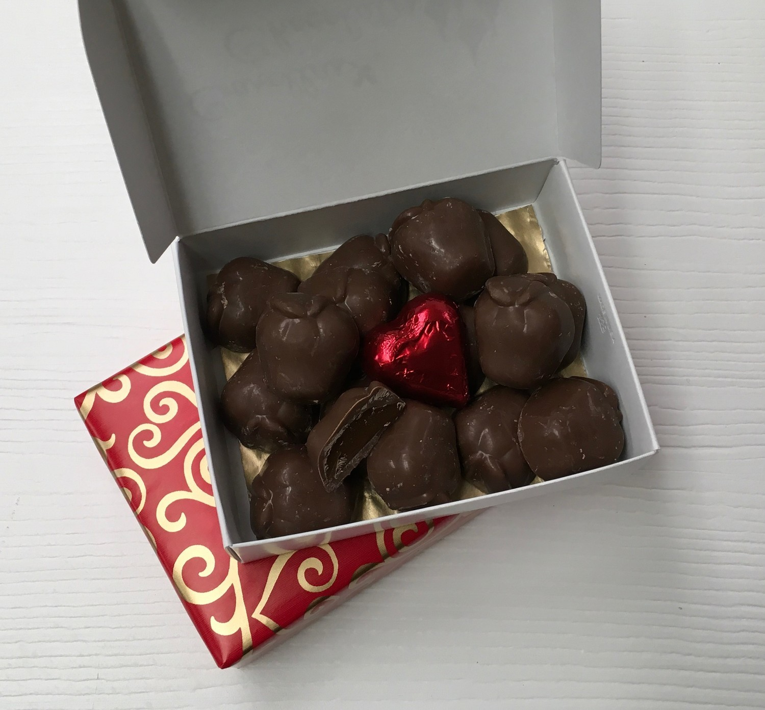 F - Great Teacher Gift!  Liquid Caramel Apples topped off with a Milk Chocolate Red Heart. Wrappped with bow.  Yum!