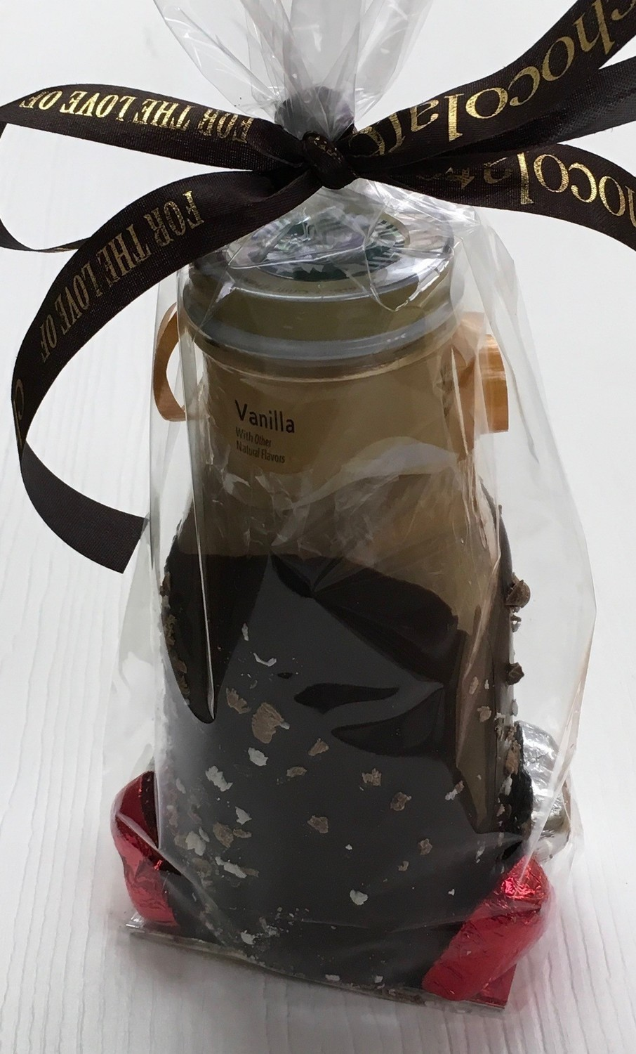 F - Starbucks Frappacino Vanilla or Coffee.  Chocolate Covered with foiled heart accents.