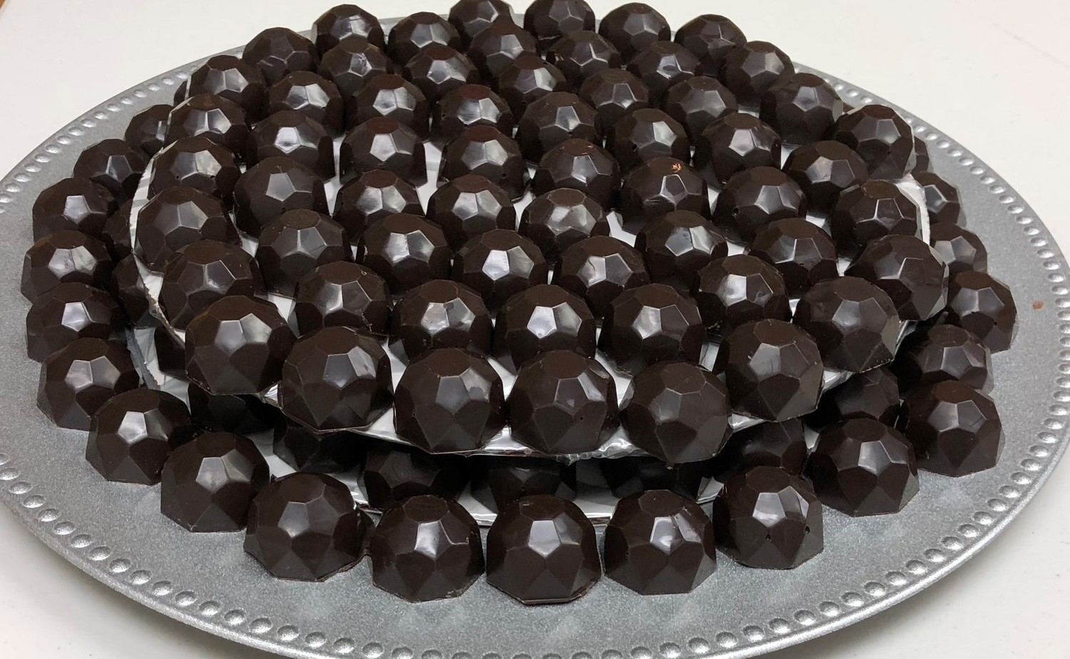 Milk or Dark Chocolate Diamond Chocolates.  These solid Chocolates are wonderful.  The shape and design of these chocolates allows them to shimmer in the light. Peanut and Gluten Free. Made here!