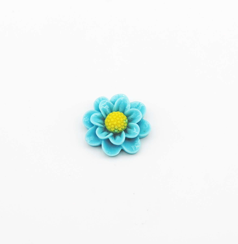 Applicazioni in resina fiorellino celeste  Pz. 72