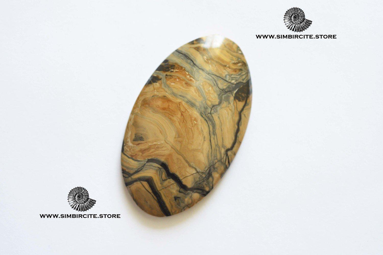 Кабошон из сенгилита 55*33*5 мм
