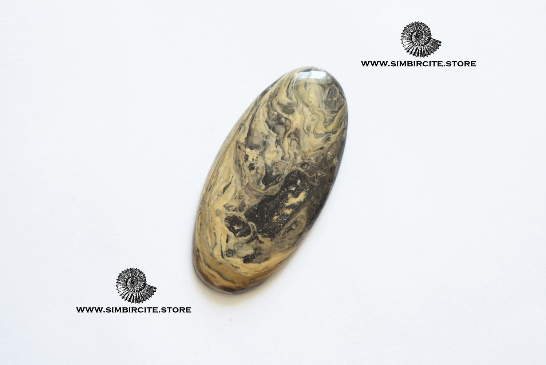 Кабошон из сенгилита 52*25*3 мм