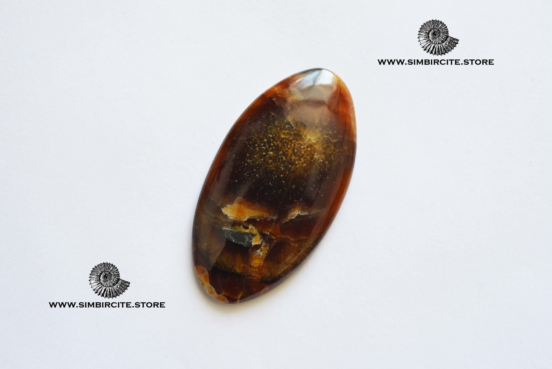 Симбирцитовый кабошон 56*30*3 мм