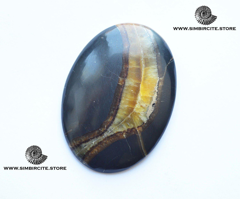 Симбирцитовый кабошон 51*37*4 мм