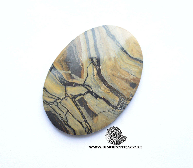 Кабошон из сенгилита 52*37*4 мм