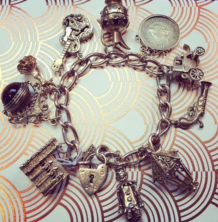 Circa 1960 9ct Gold fully loaded charm bracelet  00011