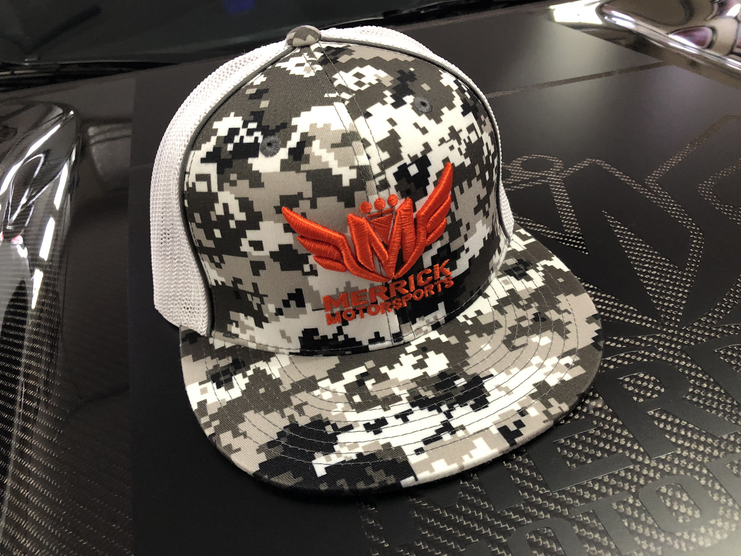 f690036bc6513 Fitted 8D8 Digital Camo Trucker Mesh Flatbill Hat with Merrick Motorsports  3D Logo