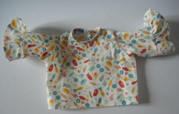 Top, cream print with mice, fish, and other items cat like