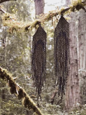 geode shoulder dusters in forest