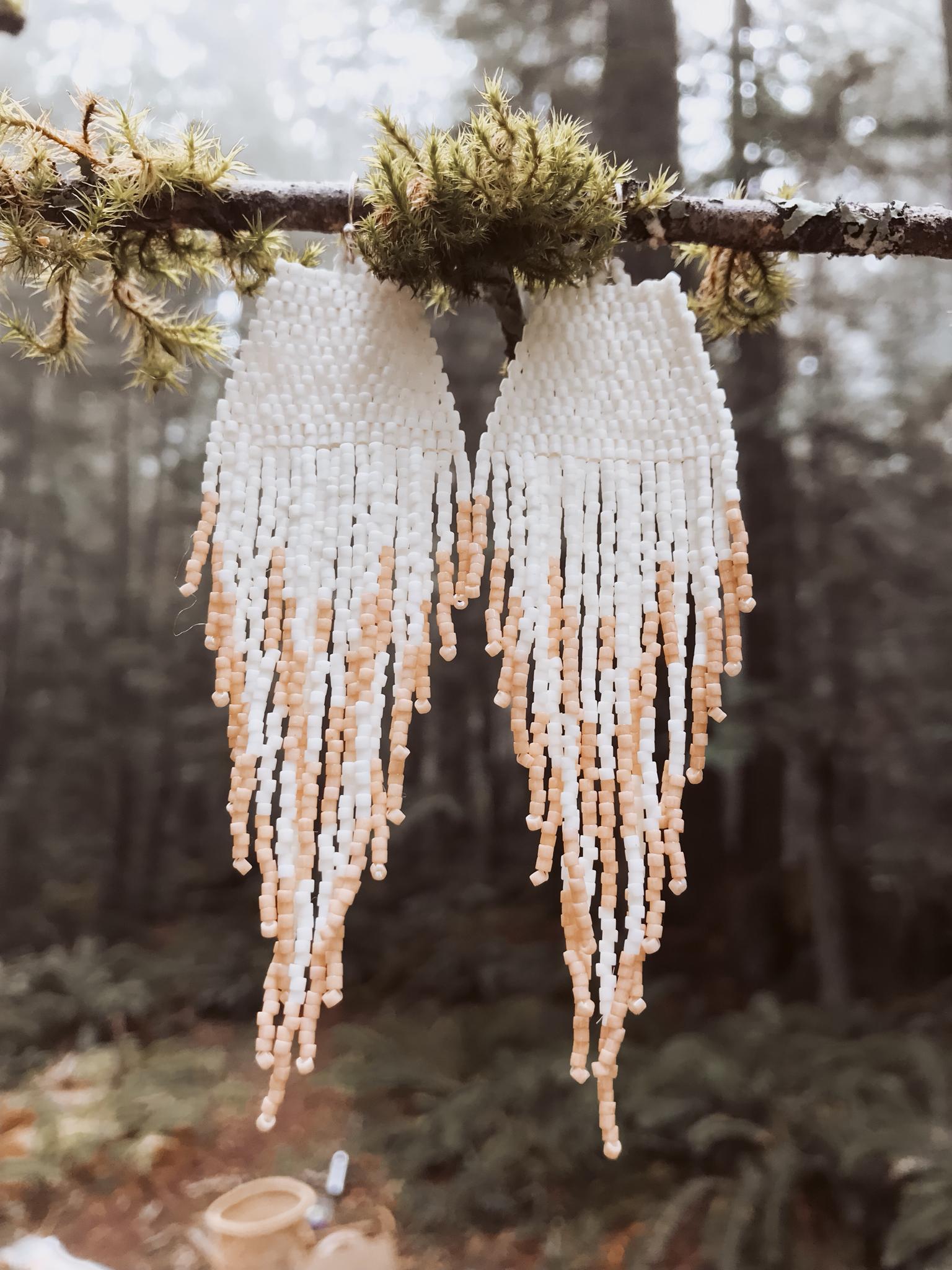 feather fringe earrings in peach