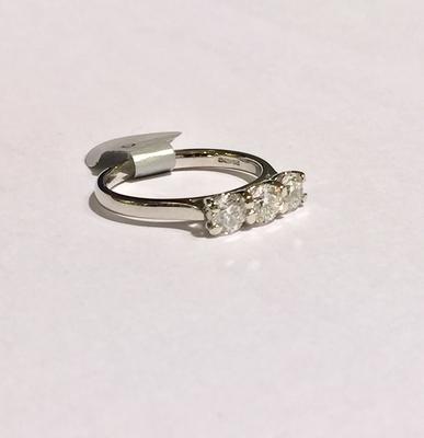 Platinum brilliant cut 3 stone diamond ring