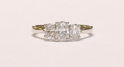 Platinum oval diamond three stone ring