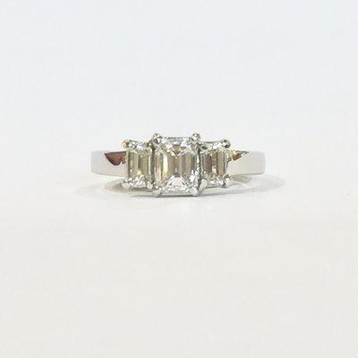 Platinum emerald cut diamond three stone ring