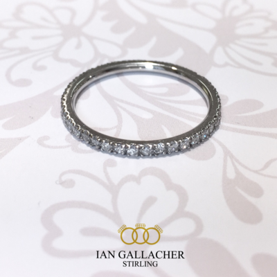 Platinum brilliant diamond slim claw set full eternity ring