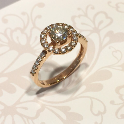 18ct Rose gold diamond halo style ring