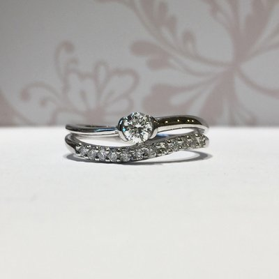 18ct white gold brilliant diamond and wave eternity ring