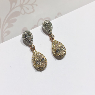 18ct gold pear shape diamond earrings