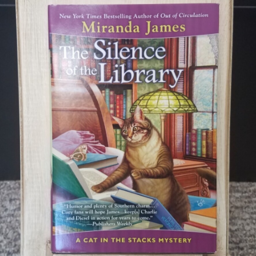 The Silence of the Library: A Cat in the Stacks Mystery by Miranda James