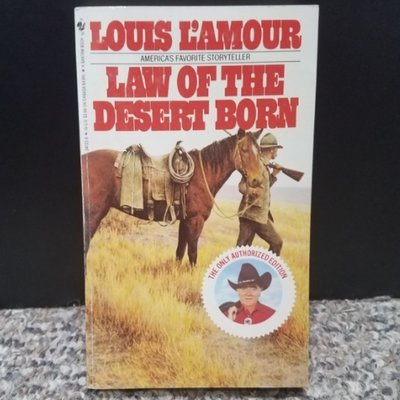 Law Of The Desert Born by Louis L'Amour