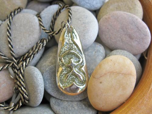 Indalo pendant - chunky metal ~ embossed Indalo