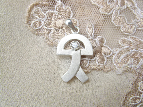 Indalo pendant ~ curved, silver + zirconite