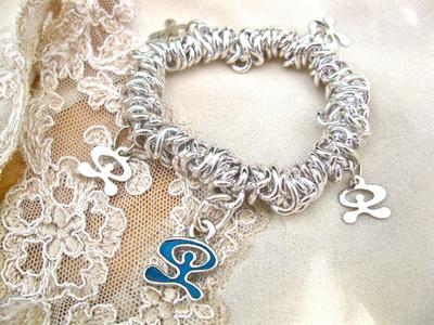 Inspirational charm bracelet ~ Indalo, mariana