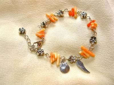 Coral travel bracelet with concha + angel wing
