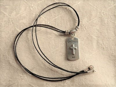 Christian cross dog tag for safekeeping