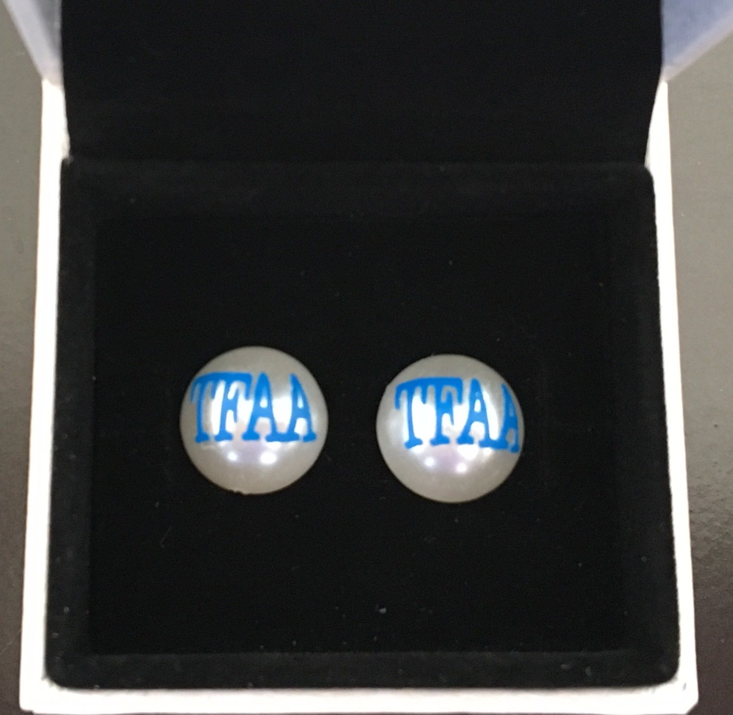 TFAA earrings