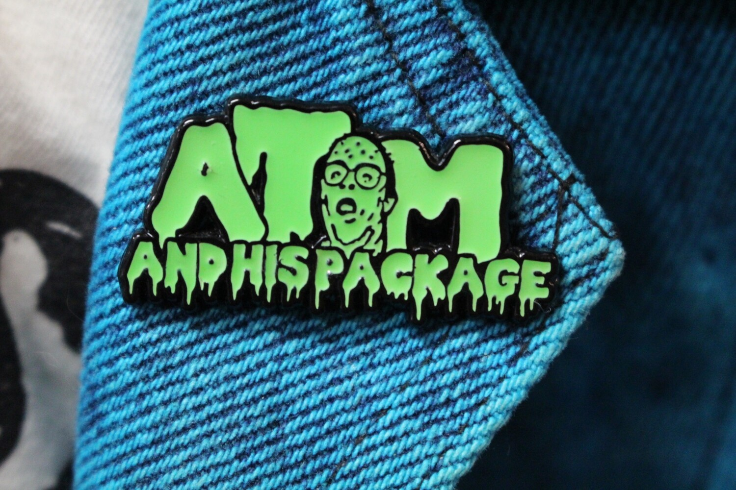 Atom And His Package Logo Pin