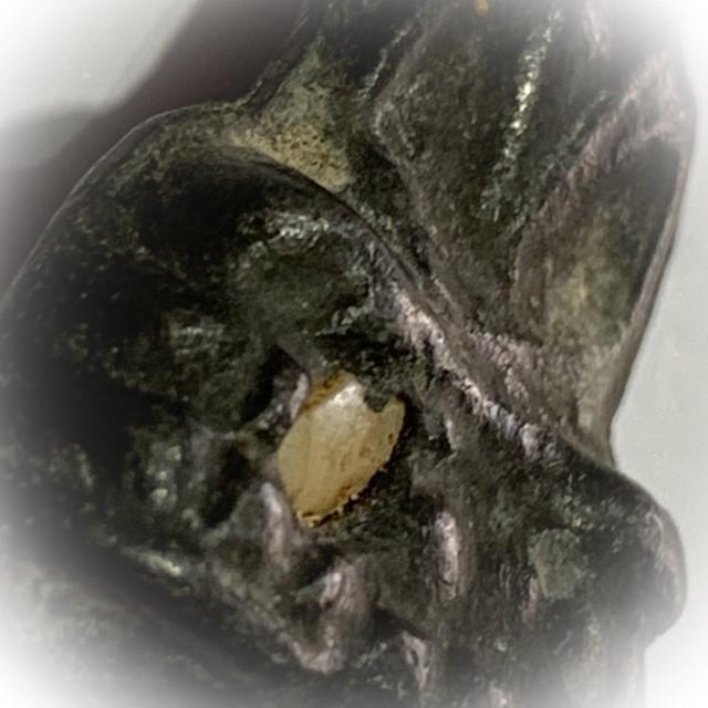 Praput Chin Dtakua Fang Khiaw Hmaa Pha 2460 BE Leaden Buddha Amulet with Wolf Tooth Insert Luang Por Dam Wat Kuti