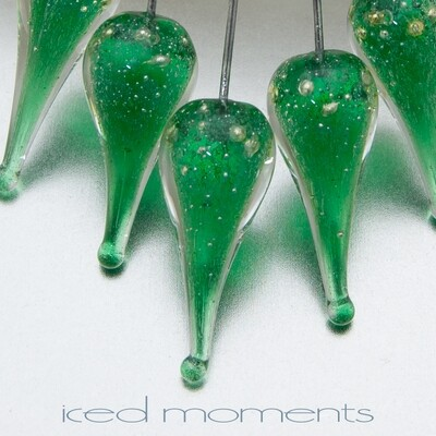 Shimmer teardrops in dark emerald green