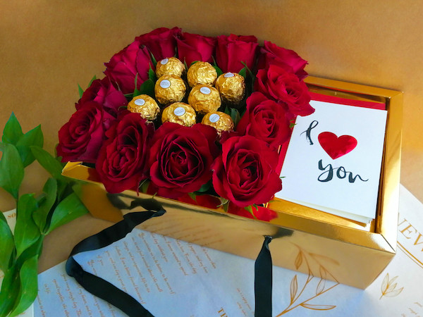Red Roses in gold box with chocolate and card