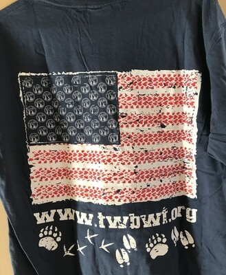 Navy t-shirt with logo in red on front and American flag with animal tracks on the back