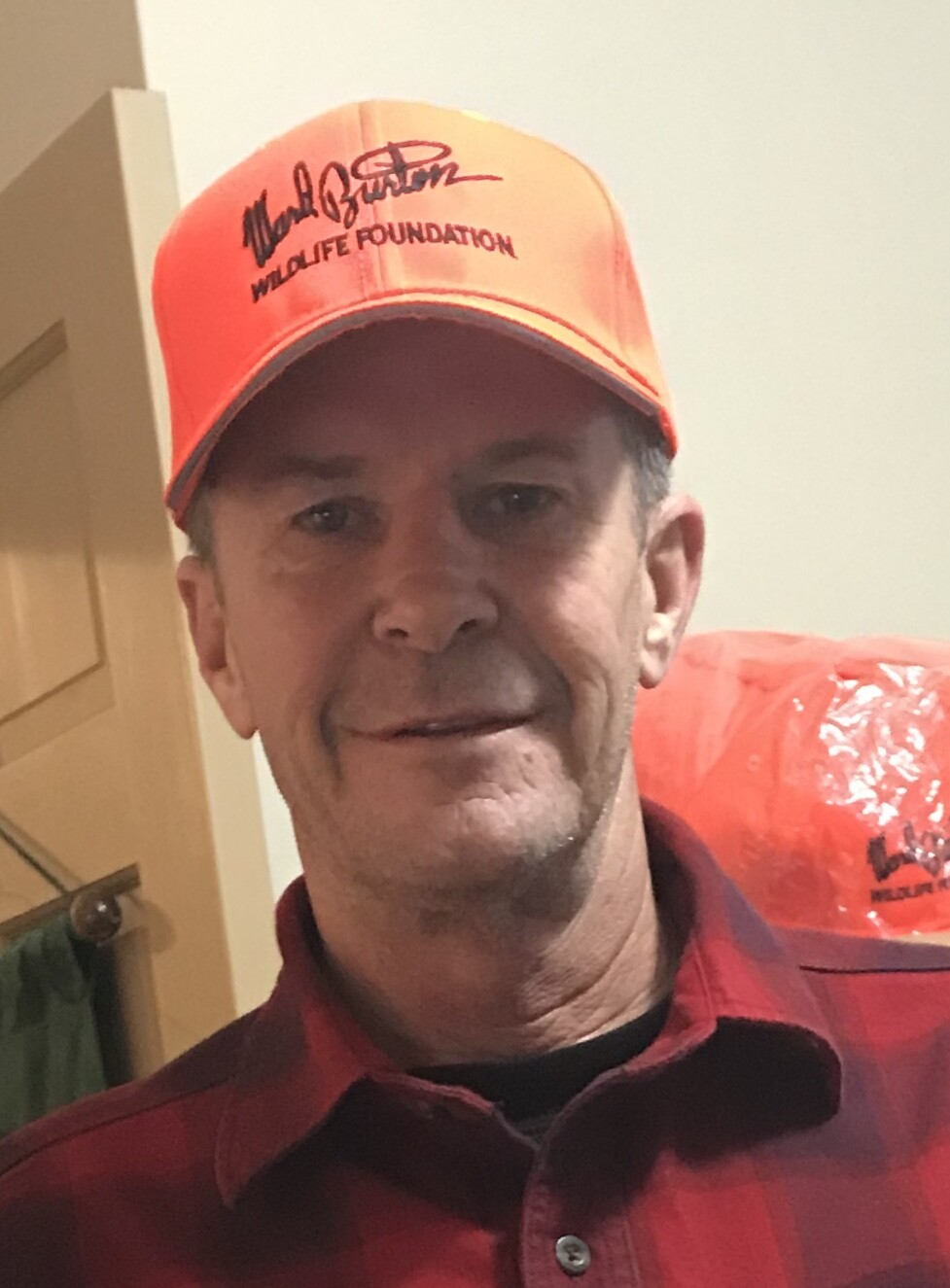 Orange cap with logo in black