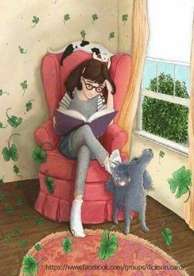 Girl in a chair reading a book