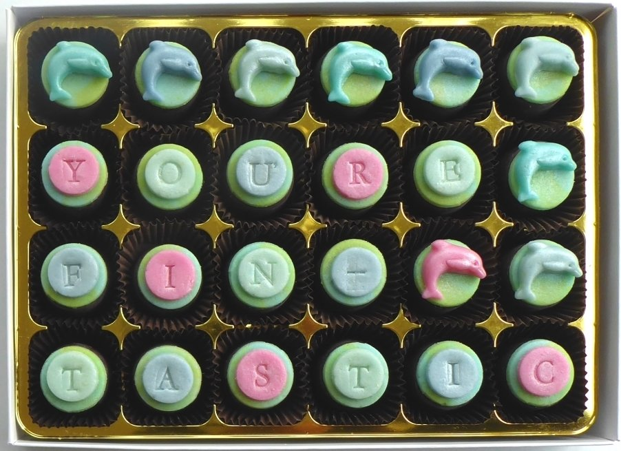 YOU'RE FINTASTIC - dolphins on chocs filled with marzipan or flavoured fondant 00029