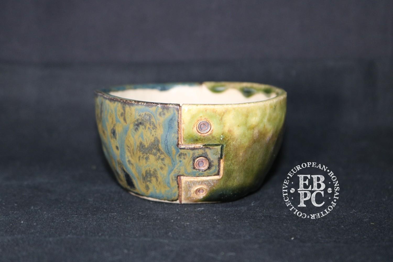 SUTEKI - 8.6cm; Accent / mame; Industrial screw design; Round; Glazed; Light green; Blue; Browns; EBPC Dual Stamped Piece; Simon Haddon